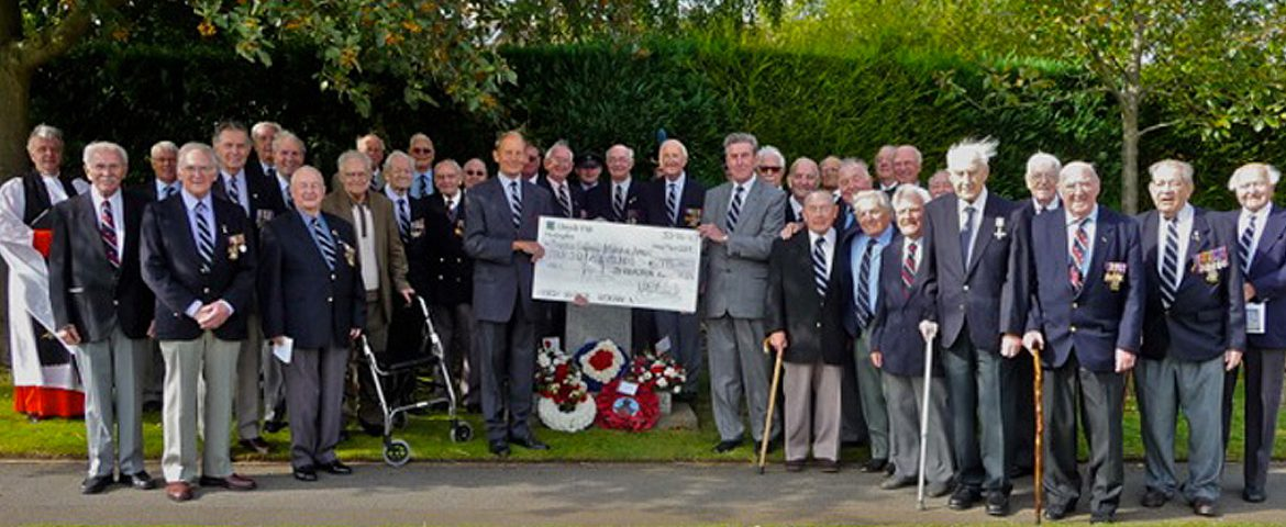 101 Squadron veterans with a memorial donation-cheque